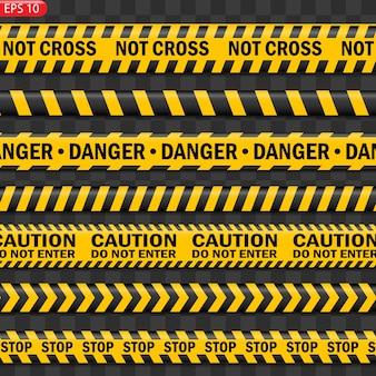 Czarne i żółte linie ostrzegawcze na białym tle. realistyczne taśmy ostrzegawcze. znaki ostrzegawcze.