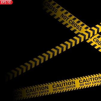 Czarne i żółte linie ostrzegawcze na białym tle. realistyczne taśmy ostrzegawcze.