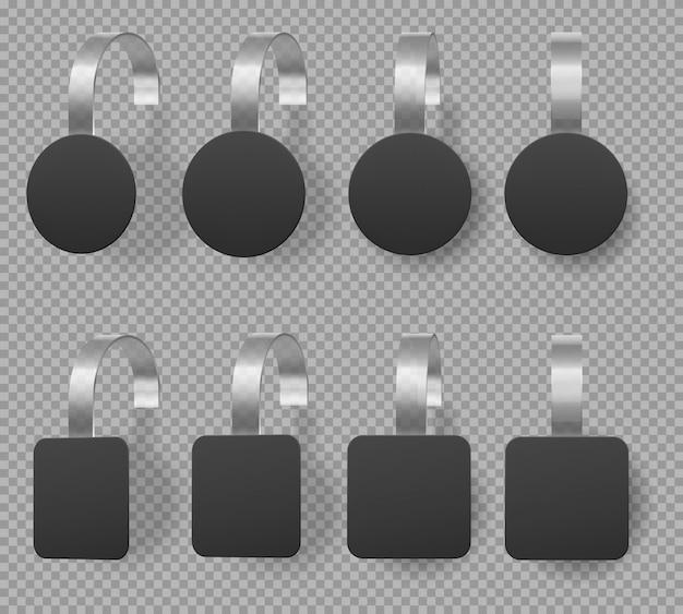 Czarne kwadratowe i okrągłe woblery, metki z ceną