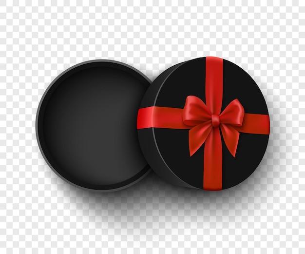 Czarne, okrągłe, otwarte pudełko z czerwoną kokardką