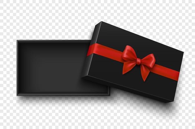 Czarne, otwarte pudełko upominkowe z czerwoną kokardką