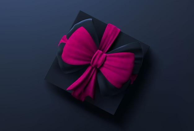 Czarne pudełko z różową wstążką i kokardą, widok z góry. pudełko na prezent na nowy rok, boże narodzenie lub walentynki.