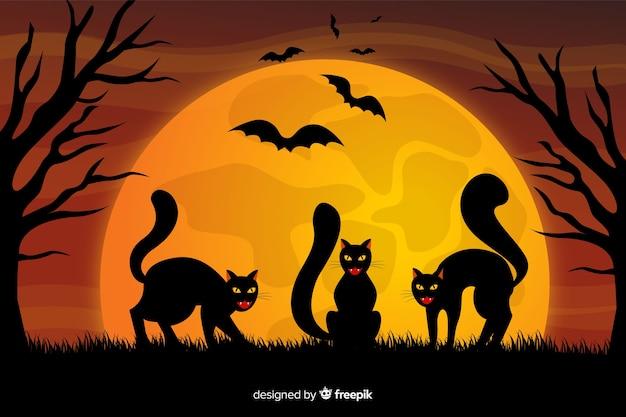Czarni koty i księżyc w pełni halloween tło