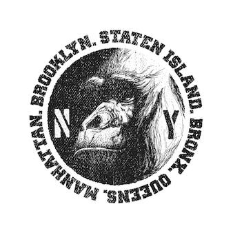 Czarno-białe logo z głową goryla.