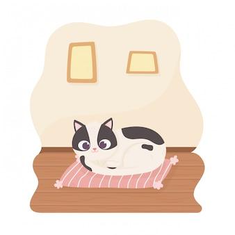 Czarno-biały kot domowych spoczywa na poduszce kreskówki