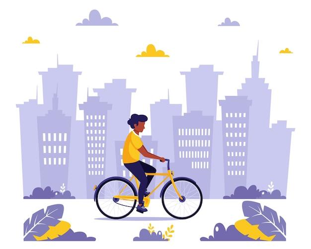 Czarny człowiek jedzie na rowerze w mieście. zdrowy styl życia, sport, koncepcja aktywności na świeżym powietrzu. w stylu płaskiej.