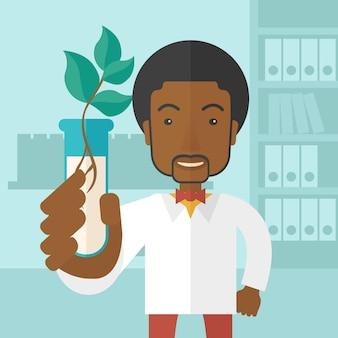 Czarny facet chemik z tubką i eko liśćmi.