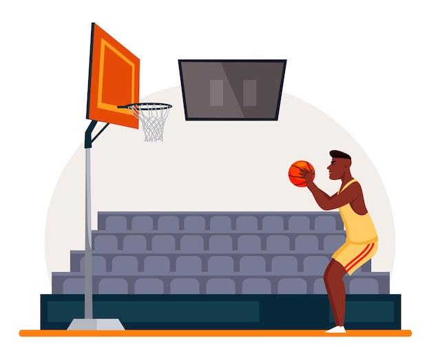 Czarny koszykarz gotowy rzucić piłkę do kosza z siatką