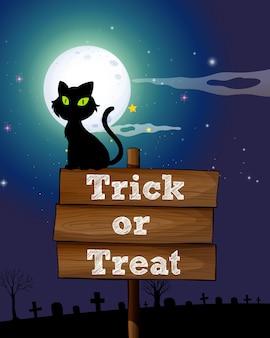 Czarny kot siedzi na drewnianym znaku w nocy