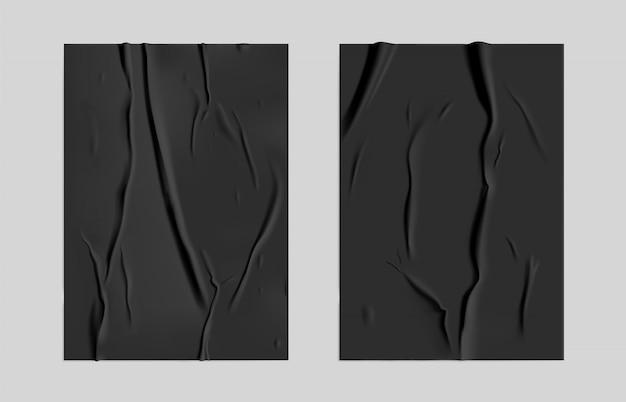 Czarny papier klejony z efektem mokrego pomarszczenia na szarym tle. szablon plakat czarny mokry papier zestaw zmięty tekstury. realistyczne plakaty