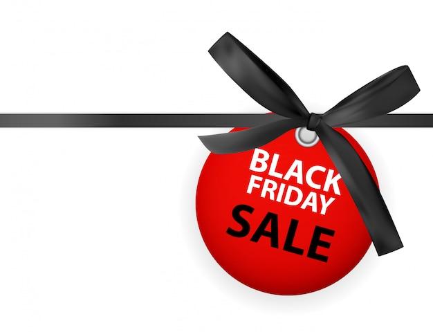 Czarny piątek sprzedaż labei z kokardą i wstążką na białym tle
