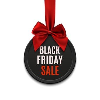Czarny piątek sprzedaż okrągły baner z czerwoną wstążką i kokardą