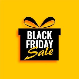 Czarny piątek sprzedaż prezent na żółtym tle