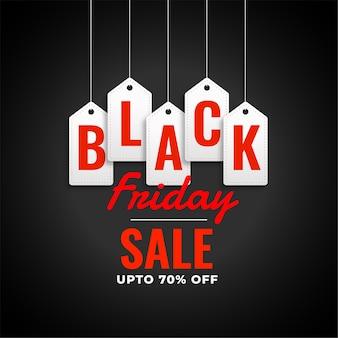 Czarny piątek sprzedaż tło z wiszącymi tagami