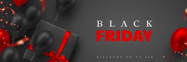 Czarny piątek sprzedaż transparent. czerwone i czarne realistyczne błyszczące balony, pudełko prezentowe i konfetti z brokatem. czarne tło. ilustracja wektorowa.