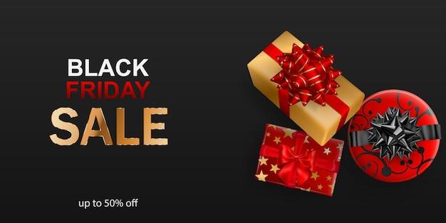 Czarny piątek sprzedaż transparent. pudełko z kokardą i wstążkami na ciemnym tle. ilustracja wektorowa na plakaty, ulotki lub karty.