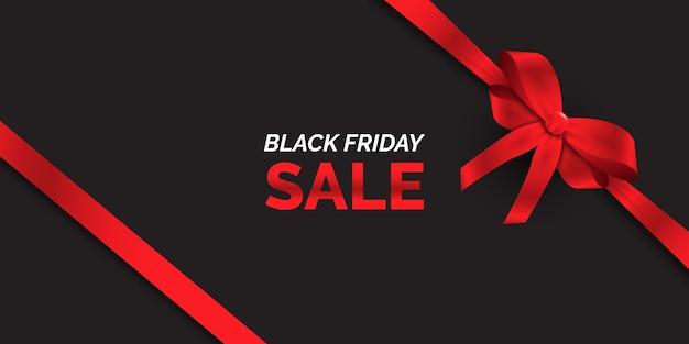 Czarny piątek sprzedaż transparent z błyszczącą czerwoną wstążką
