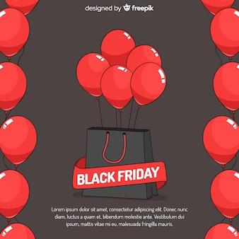 Czarny piątek sprzedaży tło z czerwonymi balonami