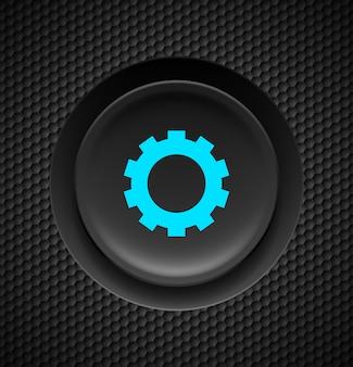 Czarny przycisk z niebieskim znakiem ustawień na tle węgla.