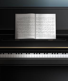 Czarny realistyczny fortepian z bliska z drukowaną muzyką
