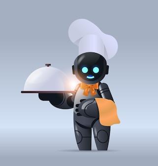 Czarny robot kucharz w kapeluszu trzymający klosz nowoczesna robotyczna postać gotująca w kuchni technologia sztucznej inteligencji