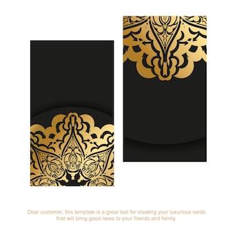Czarny szablon wizytówki ze złotym abstrakcyjnym ornamentem