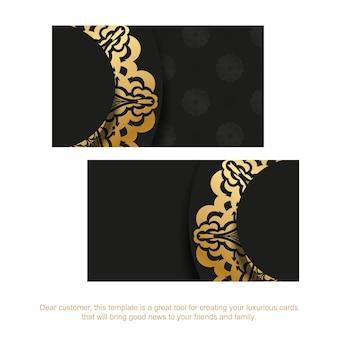Czarny szablon wizytówki ze złotym ornamentem vintage