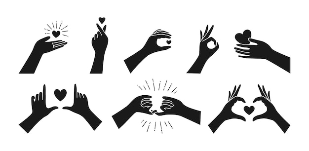 Czarny zestaw, ręka trzyma serce. symbol miłości palca, gesty rąk