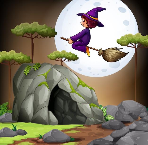 Czarownica latająca nad jaskinią