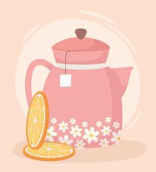 Czas na herbatę, dzbanek do herbaty i plasterki pomarańczowego napoju