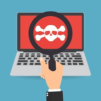 Czaszka crossbones logo na koncepcji bezpieczeństwa sieci laptopa.