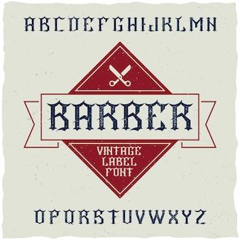 Czcionka etykiety barber shop i przykładowy projekt etykiety z dekoracją i wstążką.
