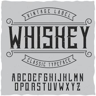 Czcionka etykiety i przykładowy projekt etykiety z dekoracją. czcionka vintage, dobra do użycia w etykietach napojów alkoholowych w stylu vintage - absynt, whisky, gin, rum, szkocka, bourbon itp.