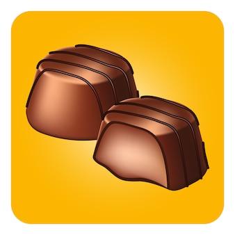 Czekoladowe cukierki na żółtym