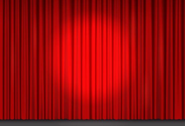 Czerwona aksamitna zasłona w teatrze lub kinie