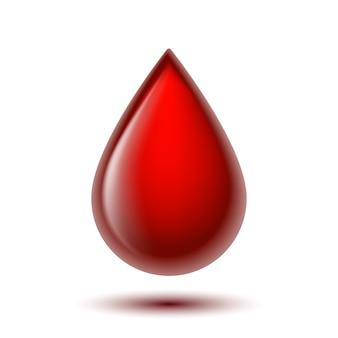 Czerwona błyszcząca kropla krwi na białym tle.