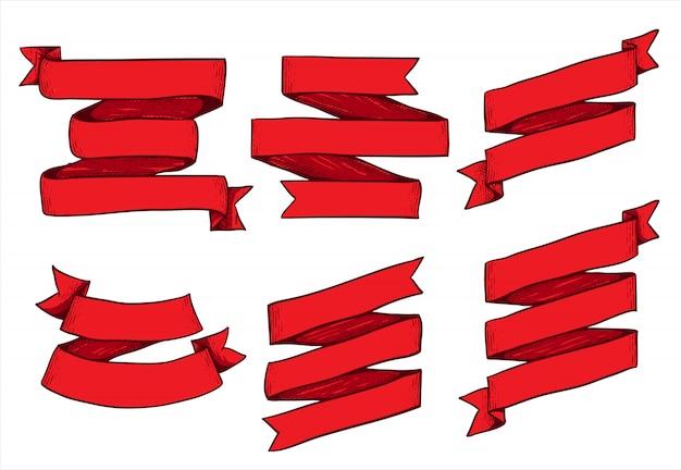 Czerwona faborek paczka odizolowywająca na bielu