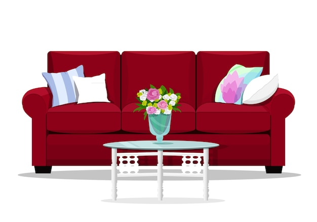 Czerwona kanapa z poduszkami i szklanym stołem.