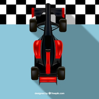 Czerwona meta wyścigowa samochodu wyścigowego przekraczania linii