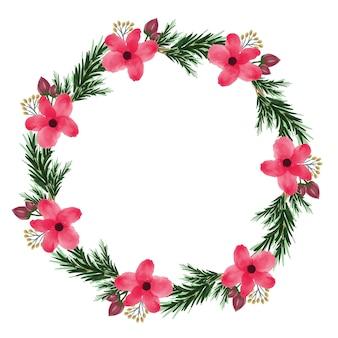 Czerwona ramka w kształcie koła z czerwonym kwiatem i liściem świerku na kartkę świąteczną