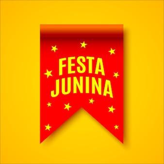 """Czerwona realistyczna wstążka z żółtymi gwiazdami. ozdoba z nazwą festiwalu brazylijskiego. . """"festa junina"""" - festiwal czerwcowy."""