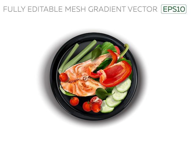 Czerwona ryba z warzywami na czarnym talerzu.