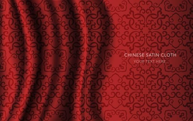 Czerwona satyna jedwabna z wzorem, kalejdoskop z łańcuszkiem krzyżowym