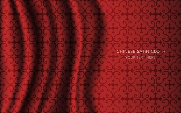 Czerwona satyna jedwabna z wzorem, krzywoliniowa ramka