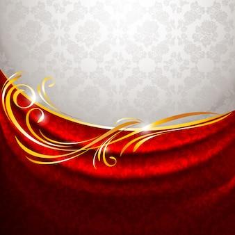 Czerwona tkanina drapuje na szarym tle