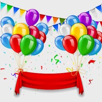 Czerwona wstążka i kilka balonów latających