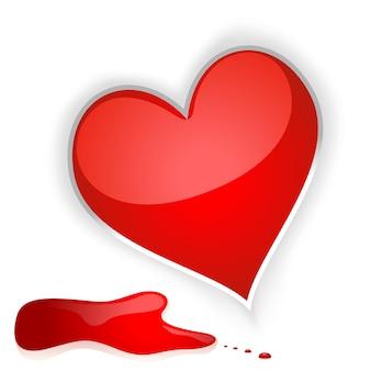 Czerwone błyszczące serce z rozpryskami krwi