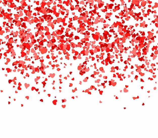 Czerwone i różowe serca spadające z nieba