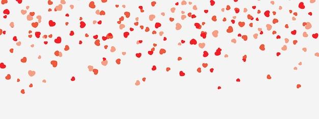 Czerwone i różowe serduszka spadają z nieba