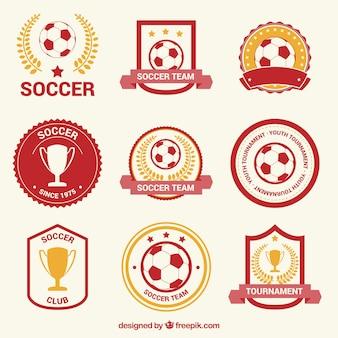 Czerwone i złote odznaki piłkarskie